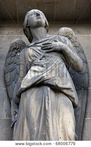 PARIS, FRANCE - NOV 09, 2012: Archangel Michael, architectural details of Eglise de la Madeleine. Madeleine Church was designed in its present form as a temple to the glory of Napoleon's army.