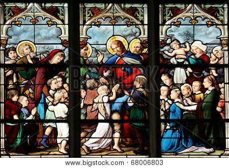 PARIS, FRANCE - NOV 11, 2012: Jesus Friend of Little Children, stained glass.The Church of St Severin is Catholic church in the Latin Quarter. It is one of the oldest churches on the Left Bank.