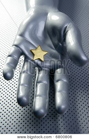Golden Star On Silver Futuristic Hand