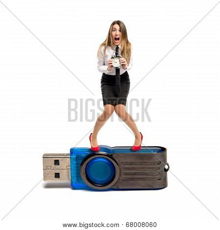 Young Businesswoman Holding An Antique Clock On Pendrive