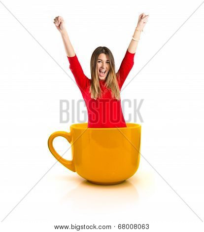 Pretty Girl Inside Cup Of Coffee Over White Background.