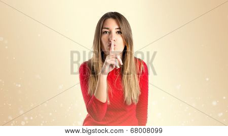 Girl Doing Silence Gesture Over Ocher Background