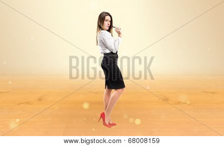 Young Businesswoman Over Ocher Background