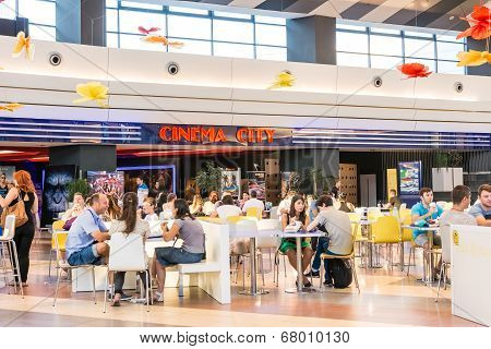 People Eating At Movie Theater Cinema