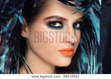 Close-up portrait of young beautiful woman with bright fancy make-up, selective focus