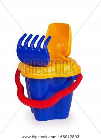 Shovel And Rake Sand In A Bucket