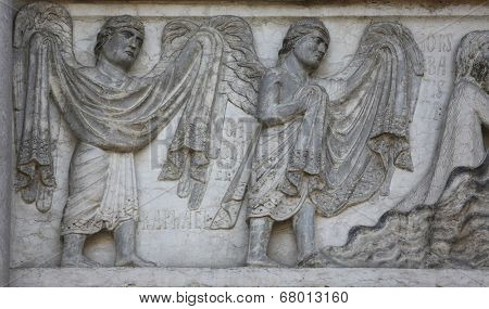 PARMA, ITALY - MAY 01, 2014: Archangels Raphael and Gabriel on the baptistery from Benedetto Antelami. Baptistery in Parma is considered to be among the most important Medieval monuments in Europe.