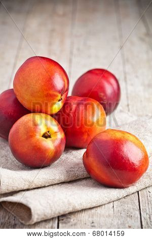 fresh nectarines on rustic wooden board