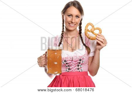 Smiling Woman In A Dirndl With A Beer And Pretzel