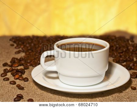 A Cup Of Coffee On Burlap On The Table
