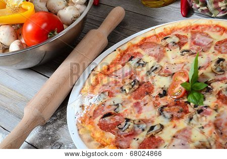The Italian pizza with olives and salami
