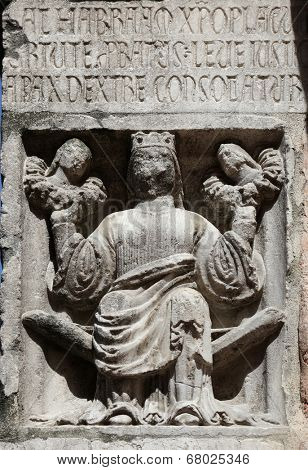 PARMA,ITALY-MAY 01, 2014:Faith(holding Justice and Peace)relief at the baptistery from Benedetto Antelami.Baptistery in Parma is considered to be among the most important Medieval monuments in Europe.