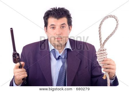 Ruined Businessman Making A Decision Between The Noose Or The Gun