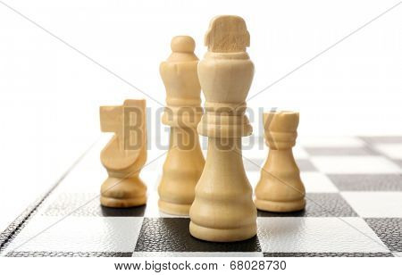 Chess board with chess pieces isolated on white