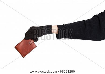 Thief Holding A Brown Leather Purse