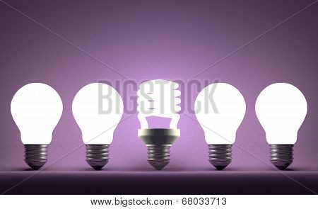 Glowing Spiral Light Bulb In Row Of Tungsten Ones On Violet