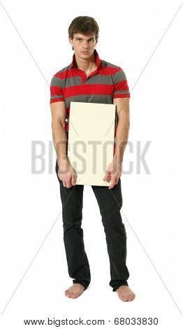 Young sexy man holding copy space blank sign isolated on white