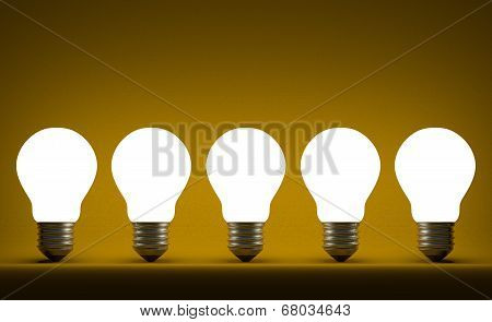 Row Of Glowing Tungsten Light Bulbs On Yellow