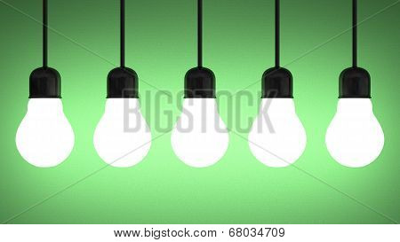 Hanging Glowing Tungsten Light Bulbs On Green