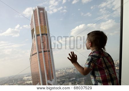 Child Looking At Skyscraper