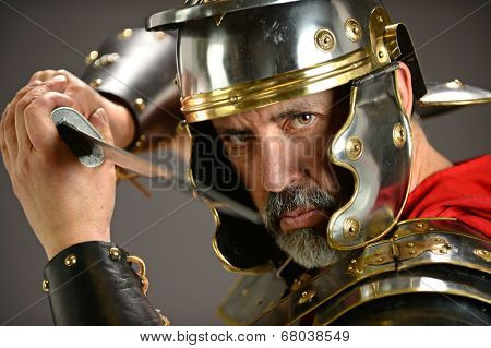 Menacing Roman soldier holding sword