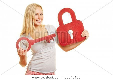 Young blond woman holding big red key and a lock