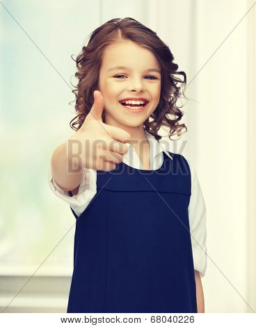 picture of beautiful pre-teen girl showing thumbs up