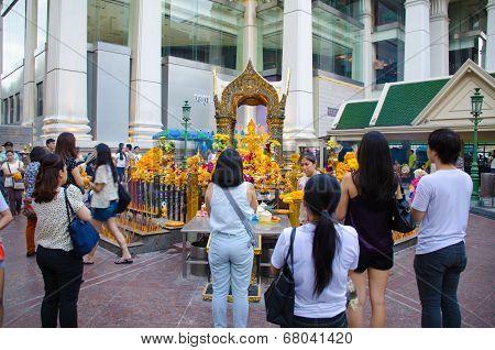 People Worship Brahma Statue