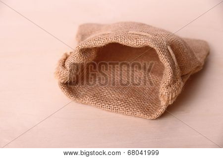 Empty Jute Sack On Wood Background