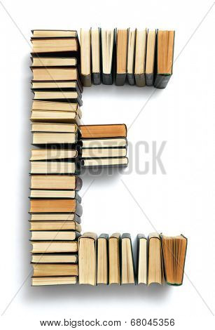 Letter E formed from the page ends of closed vintage hardcover books standing on a white background from a set or series of numbers