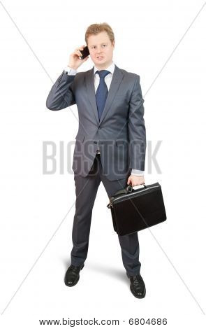 Businessman  Speaking By Mobile Over White