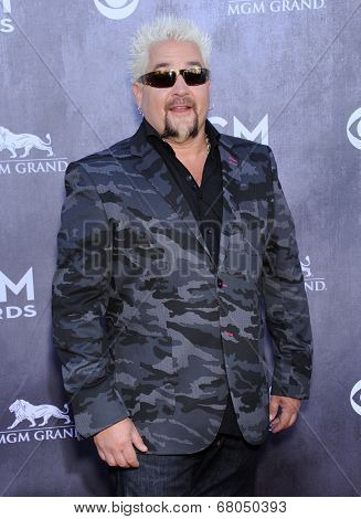 LOS ANGELES - APR 06:  Guy Fieri arrives to the 49th Annual Academy of Country Music Awards   on April 06, 2014 in Las Vegas, NV.