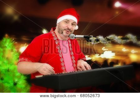 Portrait Of Santa Claus Playing Electric Piano