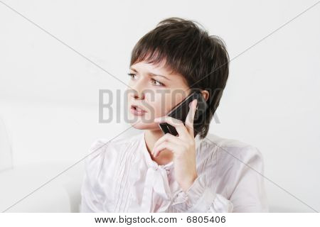 Serious Businesswoman On Phone