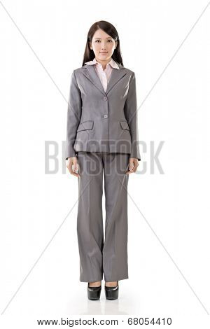 Full length portrait of Asian business woman wear pant suit, isolated on white background.