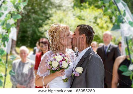 Beautiful Young Wedding Couple Kissing