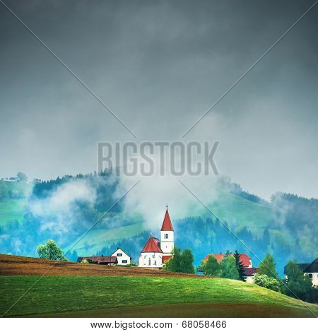 Church on the hill in the Alps. France
