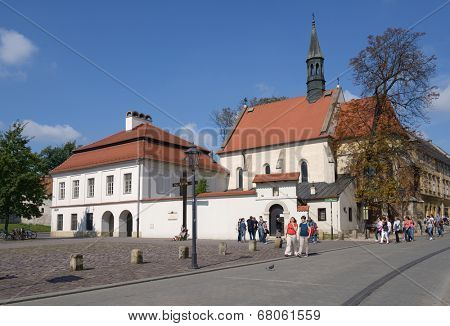 KRAKOW, POLAND - SEPTEMBER 15, 2013: Tourists near the Church of St. Giles. Gothic church was built in the first half of the XIV century, and today it's under the care of the Armenian-Catholic priests