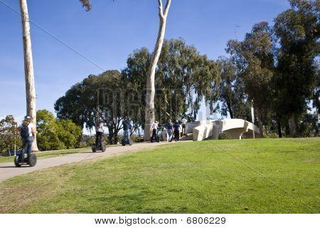 Tourists On Segways In Balboa Park
