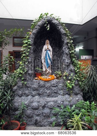 KOLKATA, INDIA - JAN 27: Statue of Our Lady of Lourdes at Mother House, where Mother Teresa used to live on Jan 27, 2009 in Kolkata, West Bengal, India.