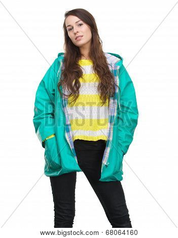 Young Woman Posing In Green Raincoat