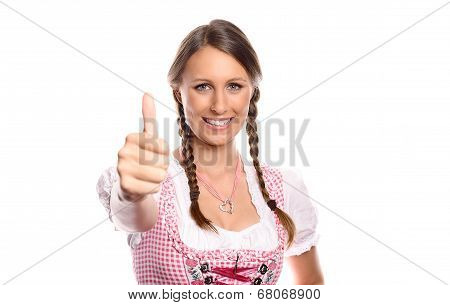 Happy Young Woman In A Dirndl Giving A Thumbs Up