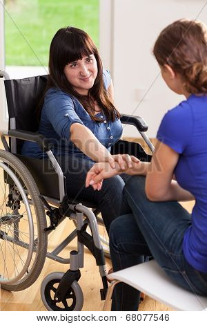 Girl On Wheelchair Talking With Female Friend