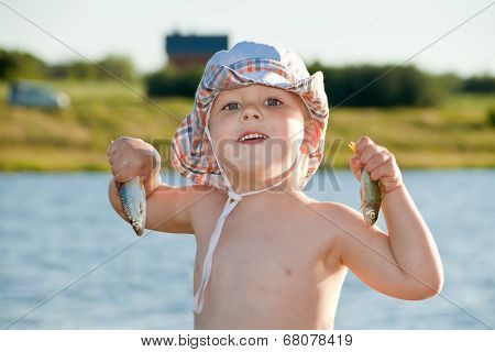 Boy Holding Two Small Fish