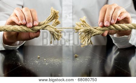 Man Holding A Rope With One Remaining String