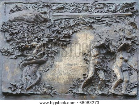 PORT AZZURRO, ITALY - MAY 03,2014: Adam and Eve, the expulsion from paradise, detail on the door of the church of St. James the Greater. The church is located inside the fort of the same name.