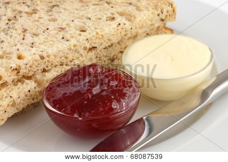 Bread with jam and butter