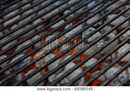 Blackened barbeque grid over hot coals