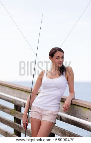 Woman on a fishing pier