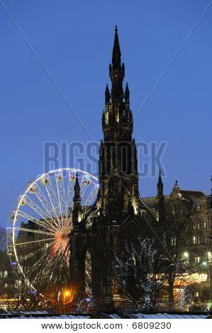 Scott Monument And Big Ferris Wheel In Princes Street Gardens, Edinburgh, Scotland, Uk